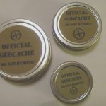 Round Geocaching Tins